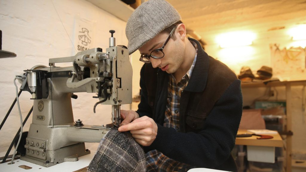 Silas Gärtner showing how to make a cap headwear