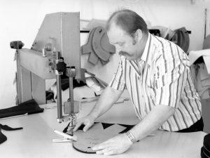 Master Bullmann cutting fabric