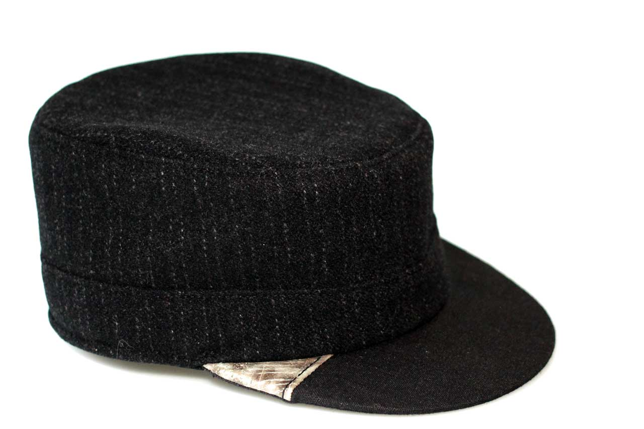 Black cap with wolffishskin detail.