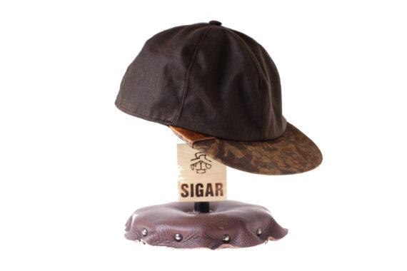 Wilgart cap in oilskin and wolffish skin detail on the side.