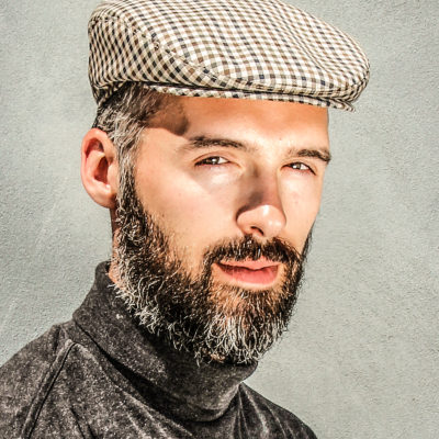 A Wilgart Flatcap on a bearded man. Cool Wool